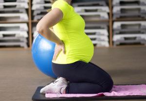 bigstock 190969069 300x208 - Future mother on prenatal yoga fitness class.