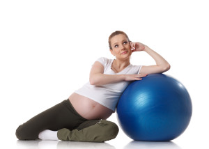 Dollarphotoclub 48928050 300x214 - Sports pregnant young woman. Fitness.